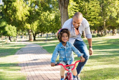 Happy Divorced Dad and Child on Bike