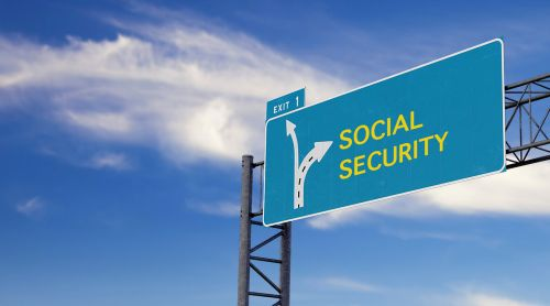 Large green highway sign with arrow to social security - BartonWood