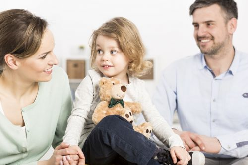 Child Support Concept - Family with daughter in forefront